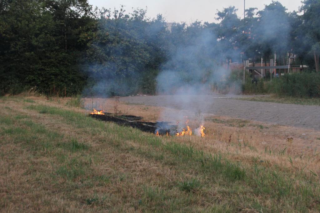 Brandweer blust bermbrand