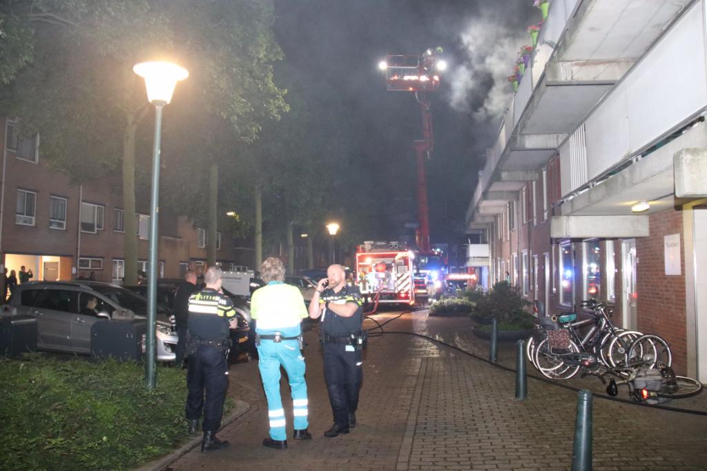 Bewoner gewond bij uitslaande brand