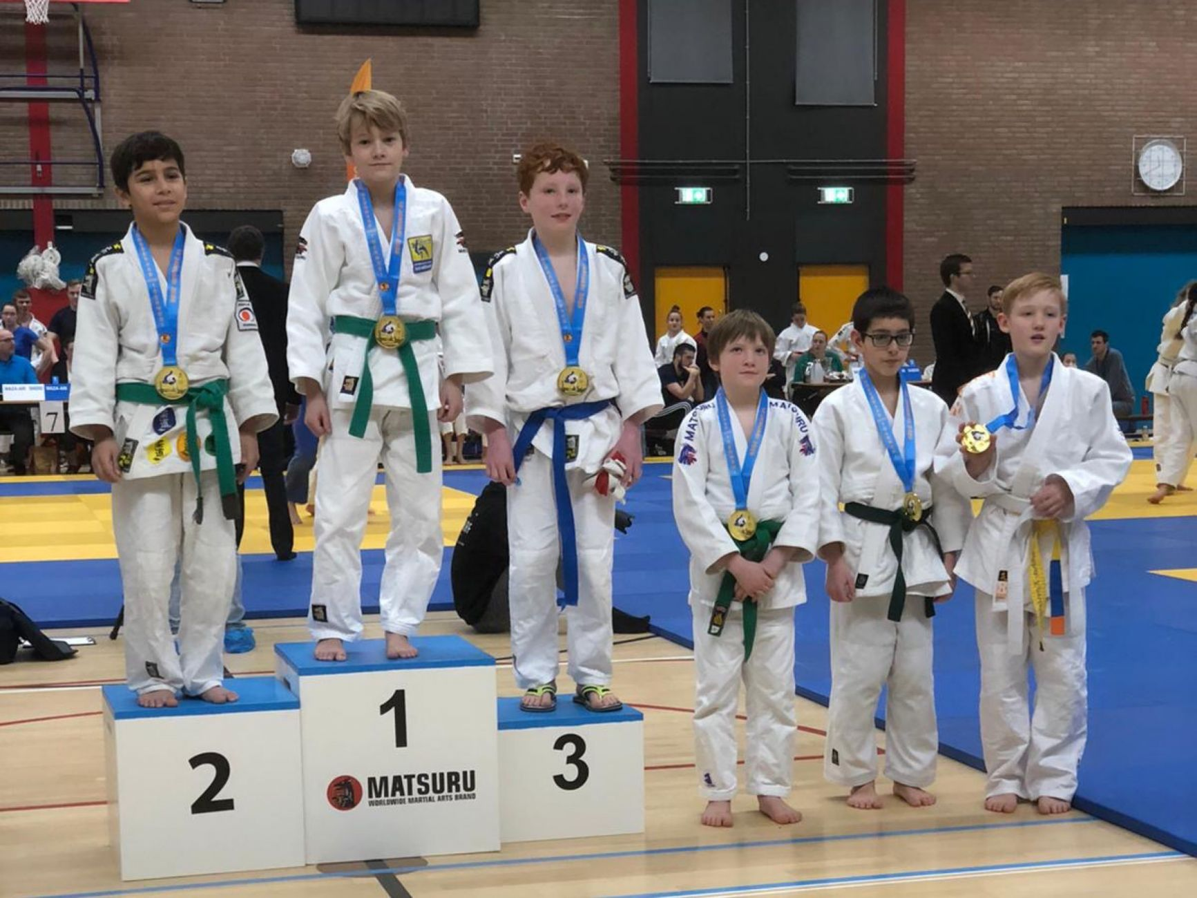 Schiedamse judoka's oogsten eremetaal