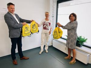 KADE40 schenkt vakantiepakketten voor kinderen aan Voedselbank