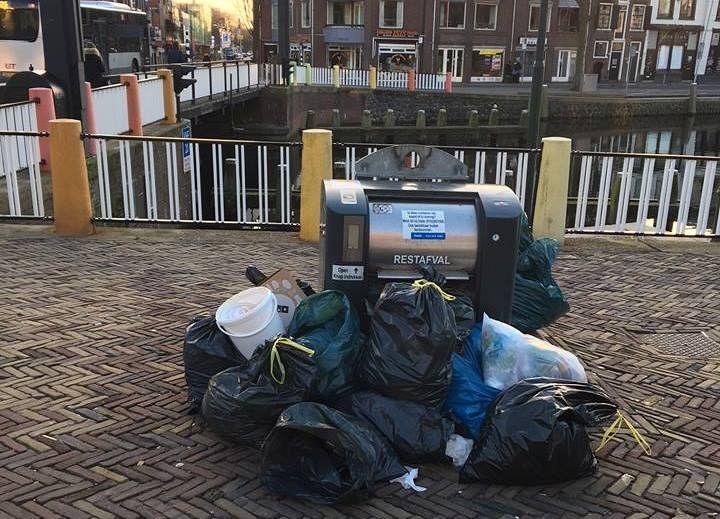 Boetes voor vuil naast container
